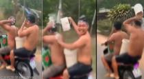 Two man bath while driving bike video goes viral