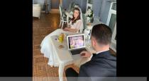 Groom playing game in laptop at marriage event