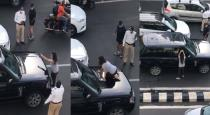 Angry-wife-fight-with-husband-in-mid-road-video-goes-vi